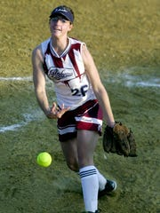 Henderson County pitcher Stacy Whitmer fires the ball to the plate during the 2004 season. Whitmer is one of 2016 inductees into the Henderson County Sports Hall of Fame.
