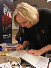 Author Rannah Gray signs copies of her book Familiar