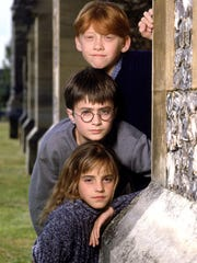 "Rupert Grint (from top), Daniel Radcliffe and Emma Watson star in ""Harry Potter and the Sorcerer's Stone."""