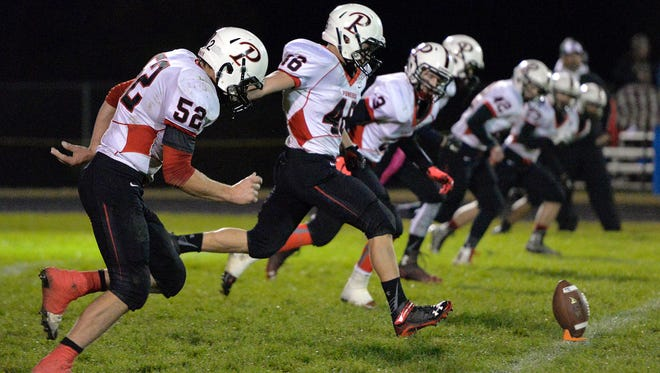 Pierz's Lane Girtz (46) kicks off in the second quarter of this season's game in Holdingford. The Pioneers are undefeated and looking to reach the state championship game.