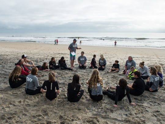 Instructor Tommy Vach, center, leads a group discussion in Ocean City on Sunday, Oct. 15, 2017.