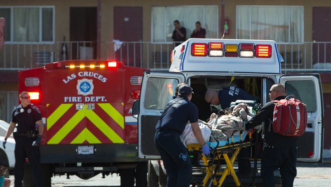 A male victim is tended to by emergency medical personal on Monday, March 21, 2016, after being stabbed at the Imperial Sky Motel located on West Picacho Ave. The patient was later airlifted to an El Paso hospital.