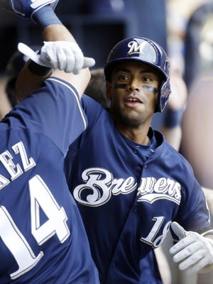 Milwaukee Brewers' Khris Davis celebrates his three-run home run with teammate Hernan Perez (14) during the eighth inning of a baseball game against the San Diego Padres Thursday, Aug. 6, in Milwaukee.