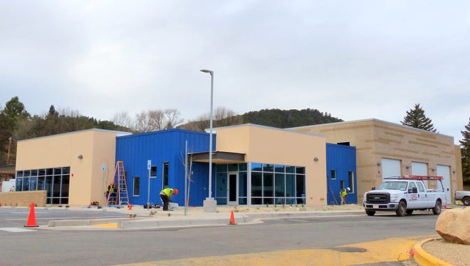 Workers prepare the new emergency medical services base for an open house Dec. 13.