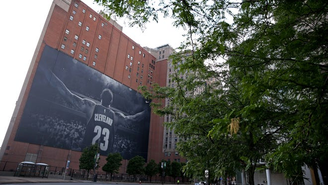 A giant LeBron James banner across the street from the Cavaliers arena could come down as soon as this week.