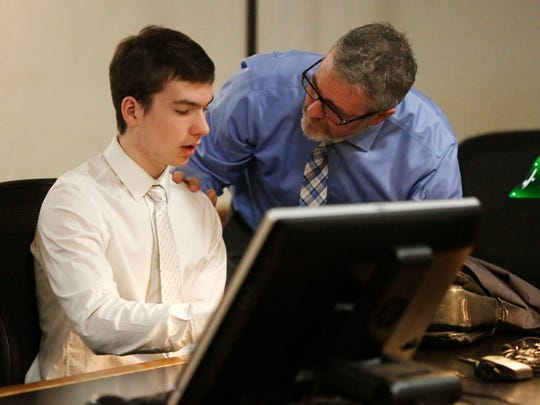 Noah Lamar, 15, goes over his plea agreement with attorney