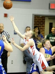 Dover's Kara Funk gets her shot off despite making contact with Kennard-Dale's Katelynn Trott during the Eagles' 39-33 win in the YAIAA girls' tournament quarterfinals. (Daily Record/Sunday News -- Jason Plotkin)