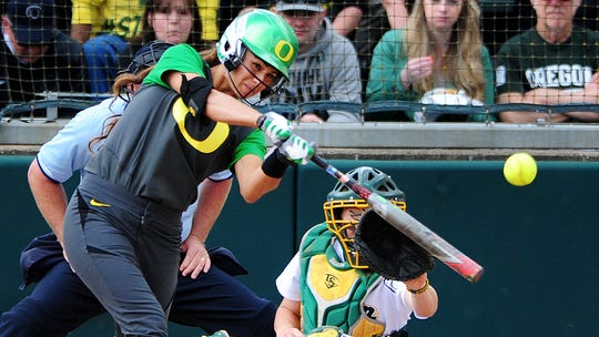 Oregon batter Nikki Udria hits a stand-up double against