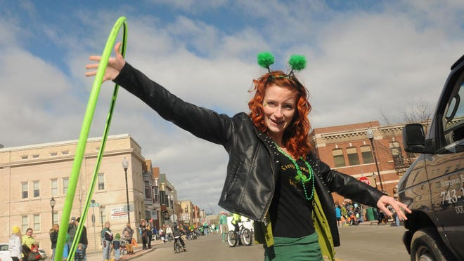 An appropriately dressed Kelsey Durante twirls a hoola hoop for the Kitty O'Reillys Irish Pub float in last year's Sturgeon Bay St. Patrick's Day parade.