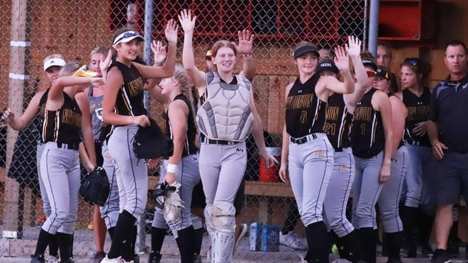Members of the New London High School softball team waves to the Winfield-Mount Union players after the Tigers' 5-1 victory over the Lady Wolves in a Class 1A regional quarterfinal game Thursday at Winfield.