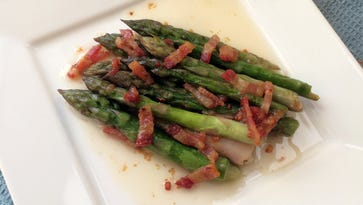 Fresh asparagus is even better with hot bacon dressing