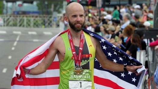 Scott Wietecha draped the American flag over his shoulders after winning the Nashville Marathon for the third time in 2015.