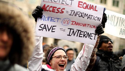 Demonstrators rally outside the Federal Communication Commission building to protest against the end of net neutrality rules Dec. 14, 2017, in Washington, DC.