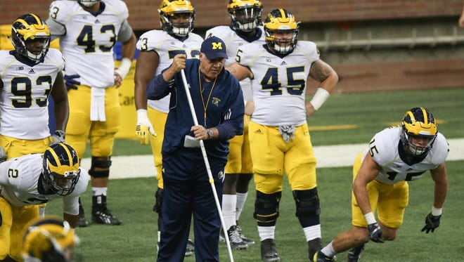Michigan Wolverines defensive line coach Greg Mattison puts his players through drills during spring practice Saturday, March 26, 2016 at Ford Field in Detroit.
