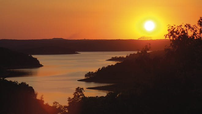 The sun sets over Norfork Lake in this Baxter Bulletin file photo. The sun rises in the east, travels across the sky and sets in the west every day, giving the illusion that the star is orbiting the earth.