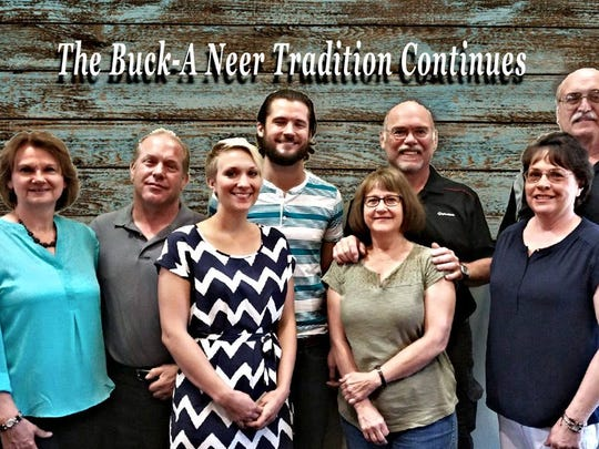 The Buck-A-Neer Supper Club has new owners as the Jasurdas, (left to right) Judy and Dave and Elizabeth and her fiancee will run the supper club. Past owners Roy and Jeannie and Tom and Anne's family the Seuberts owned the place for 43 years.