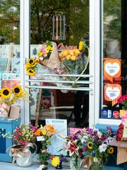A small memorial has been created outside the Red Arrow,