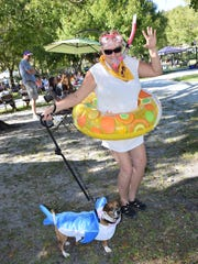 Susan Micheel and her therapy dog, Cody, the Land Shark, at the 2016 Howl-O-Ween Dog Costume Pawrade in Vero Beach.