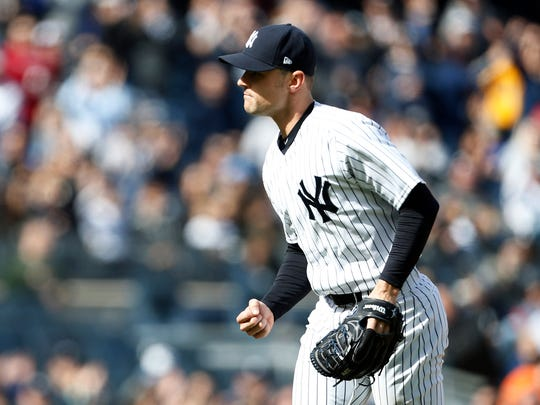 Apr 7, 2018; Bronx, NY, USA; New York Yankees relief pitcher David Robertson (30) reacts after the final out against the Baltimore Orioles during the seventh inning at Yankee Stadium.