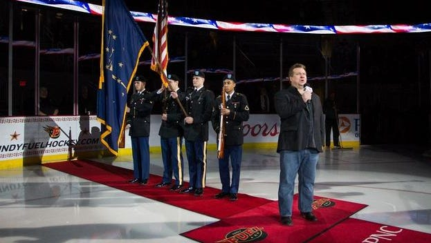 Eric Wickens, shown singing the national anthem at an Indy Fuel hockey game, hopes to make a music video and concert video showcasing his voice.