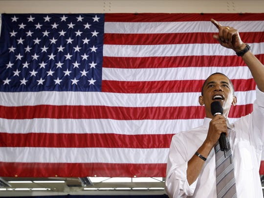 Barack Obama, as a candidate for president, speaks during a town hall meeting at Mott Community College Regional Technology Center in Flint, Mich., Monday, Sept. 8, 2008. (AP Photo/Chris Carlson)