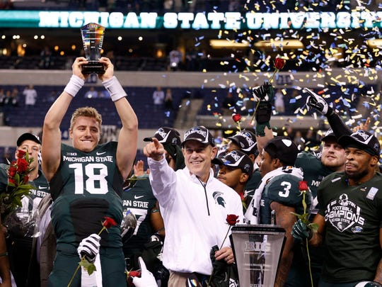 Ohio natives Connor Cook, left, and Denicos Allen, far right, were instrumental in the Spartans' rise as a program and 2013 Big Ten championship win over Ohio State. The Buckeyes didn't recruit either of them.