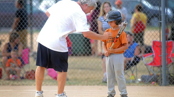 In this photo from 2012, the author gives hitting tips