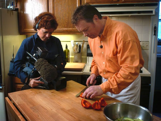 Dan Eaton, right, is videotaped slicing peppers by