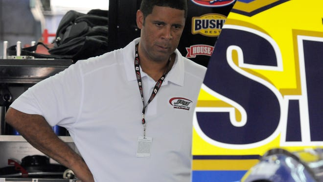 Brad Daugherty looks at his NASCAR car before practice for Coca-Cola 600 auto race at Charlotte Motor Speedway in May .