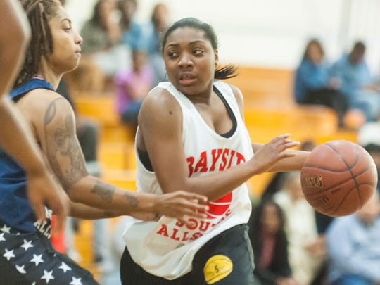 Mardela guard Demyra Selby (5) drives against the Bayside North All-Stars on Wednesday evening in the Waller Dome.