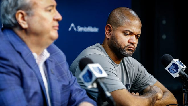 Memphis Grizzlies new interim head coach J.B. Bickerstaff (right) listens to General Manager Chris Wallace (left) talk to the media during a press conference at the FedExForum in Memphis, Tenn., Tuesday, November 28, 2017.  Bickerstaff, who was the Grizzlies associate head coach takes over recently fired head coach David Fizdale.