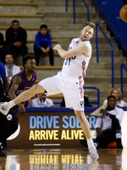 Former Sanford and Syracuse star Trevor Cooney of the Long Island Nets (right) tries to deflect a pass by 87er Nate Robinson in the first half at the Bob Carpenter Center Friday.