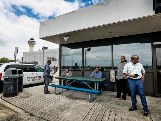 Taxi drivers wait outside the drivers' lounge at Memphis