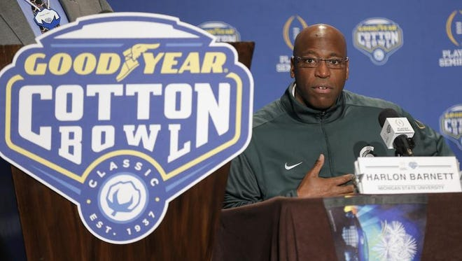 Michigan State defensive coordinator Harlon Barnett gives an opening statement during a news conference for the NCAA Cotton Bowl college football game against Alabama Sunday in Dallas.
