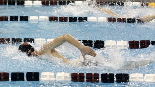 Jamie Lovette of Ithaca swims the opening leg for the Little Red's victorious 400-yard freestyle relay Saturday at the John Beecher Boys Swimming and Diving Invitational at Ernie Davis Academy.