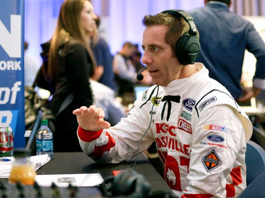 Greg Biffle answers questions in a radio interview during NASCAR media day at Daytona International Speedway, Tuesday, Feb. 16, 2016, in Daytona Beach, Fla. (AP Photo/John Raoux)