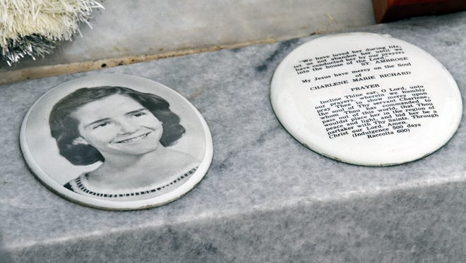 "The gravesite of Charlene Richard, also known by many as the ""Little Cajun Saint,"" is pictured at the St. Edward Catholic Church Cemetery in the community of Richard."