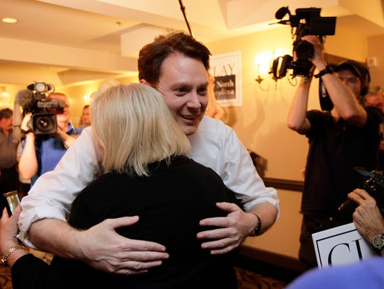Clay Aiken hugs a supporter during an election night watch party in Holly Springs, N.C., Tuesday, May 6, 2014. Aiken is seeking the Democratic nomination for North Carolina's 2nd Congressional District. (AP Photo/Gerry Broome)