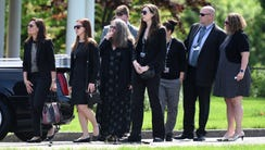 Mourners leave Marrocco Memorial Chapel following the