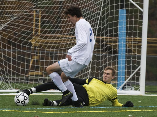 Lake Region's Liam Kennedy (42) makes a foot save on a shot by Milton's Carson Bianchi (2) during the division II boys soccer championship game between the Rangers and the Milton Yellow Jackets at South Burlington high school on Saturday morning November 5, 2016 in South Burlington.