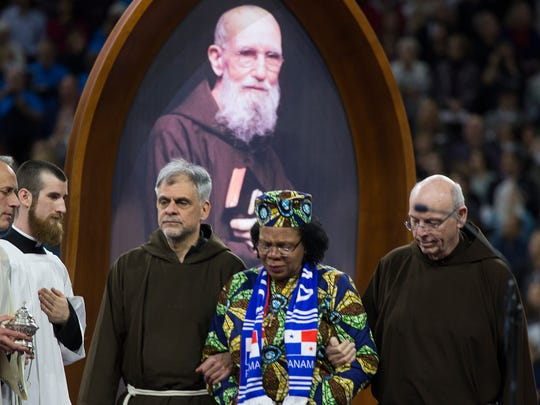 Paula Medina Zarate of Panama is escorted during Saturday's ceremony that celebrates the beatification of Father Solanus Casey, Saturday Nov. 18, 2017 at Ford Field in Detroit. Casey co-founded Detroit's Capuchin Soup Kitchen.