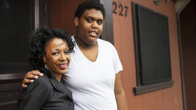 Lillianna Willis, 17, poses with Rita Gaither outside of Lillianna's home on Parsells Avenue last month. Gaither has worked to ensure that Lillianna attends classes at Edison High School.