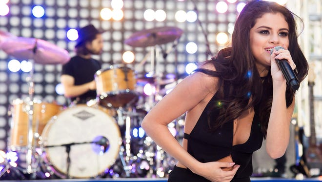 """Selena Gomez performs on NBC's """"Today"""" show at Rockefeller Plaza on Monday, Oct. 12, 2015, in New York. (Photo by Charles Sykes/Invision/AP)"""