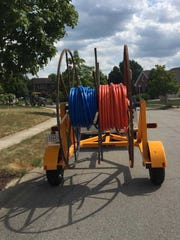 MetroNet fiber optic cables wait to be buried in Hamilton