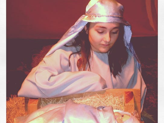 Matty Hohhertz, as Mary, beside baby Jesus in the 2013