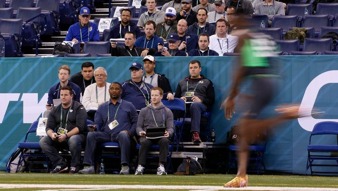 Feb 29, 2016; Indianapolis, IN, USA; West Virginia defensive back Daryl Worley (R) runs past the stop watch timers as he runs the 40 yard dash during the 2016 NFL Scouting Combine at Lucas Oil Stadium. Mandatory Credit: Brian Spurlock-USA TODAY Sports