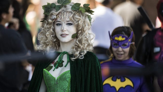 """Eliana Burns, dressed as Titania from Shakespeare's play """"A Midsummer Night's Dream,"""" waits to take the stage during Tempe Public Library Comicon 2018 at Tempe Public Library on Jan. 27."""