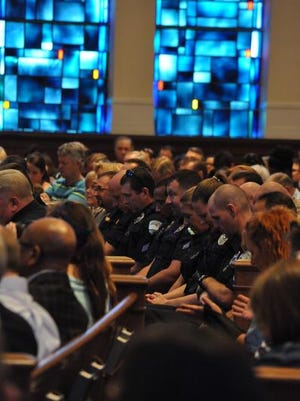 Hundreds packed First Baptist Church Pineville on Monday for a Prayer Rally for Our Police.