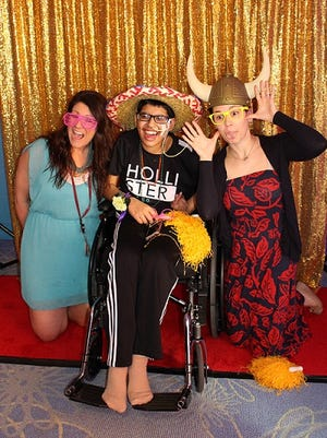 Alshay Patel (center) and his therapists, Candice Short and Alexandra Price, having fun in the photo booth at Children's Specialized Hospital's Inpatient Prom.