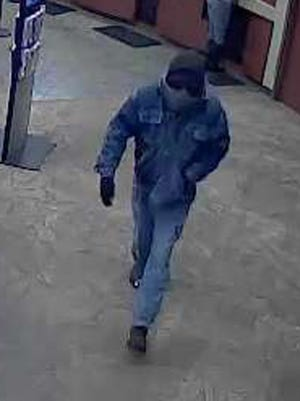 The suspect in a bank robbery Monday morning at an ESL on Merchants Road in Rochester.